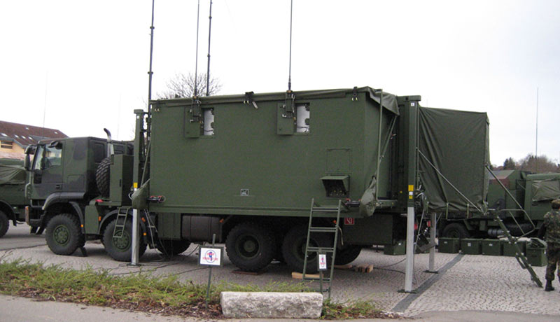 Deployable container operated on a truck
